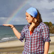 German visitor catches a rainbow, right here in Magical Mangawhai